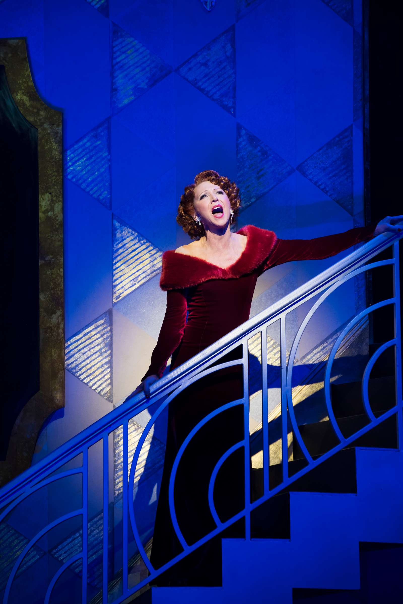 Bonnie Langford sings from a staircase while playing Dorothy Brock in 42nd Street in London