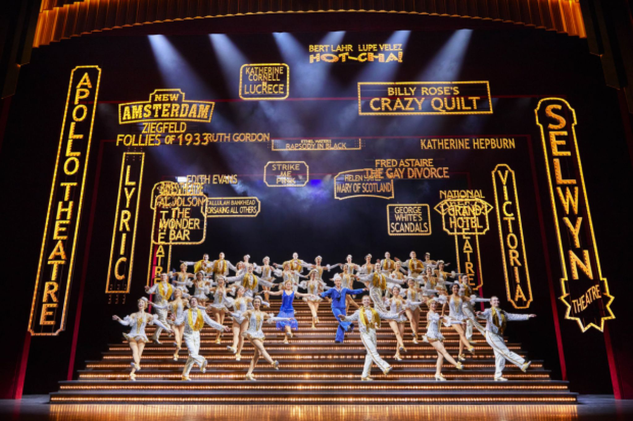 The 50 strong company of 42nd Street in London performs a dance number on a set of stairs that fill the stage