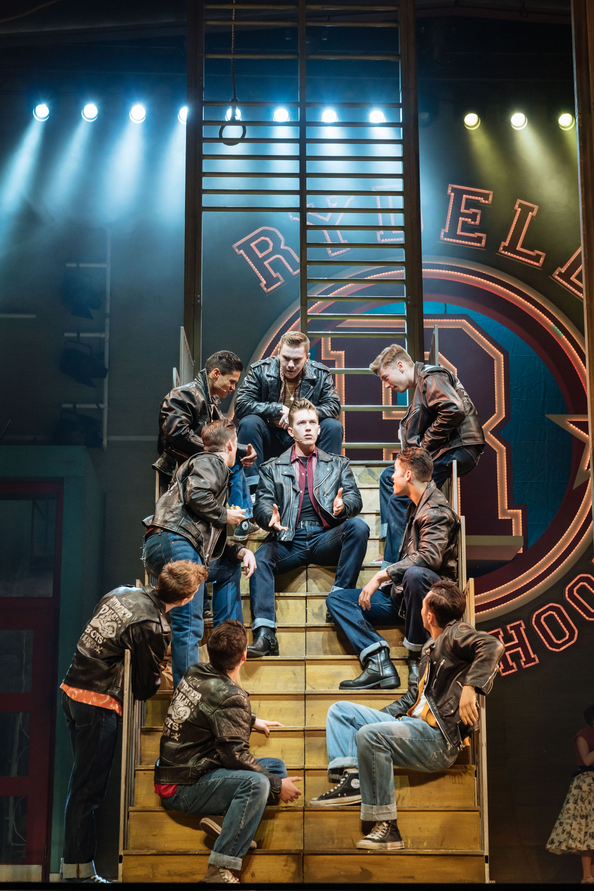 Dan Partridge as Danny (centre) and the T-Birds in the UK and Ireland tour of GREASE, credit Manuel Harlan