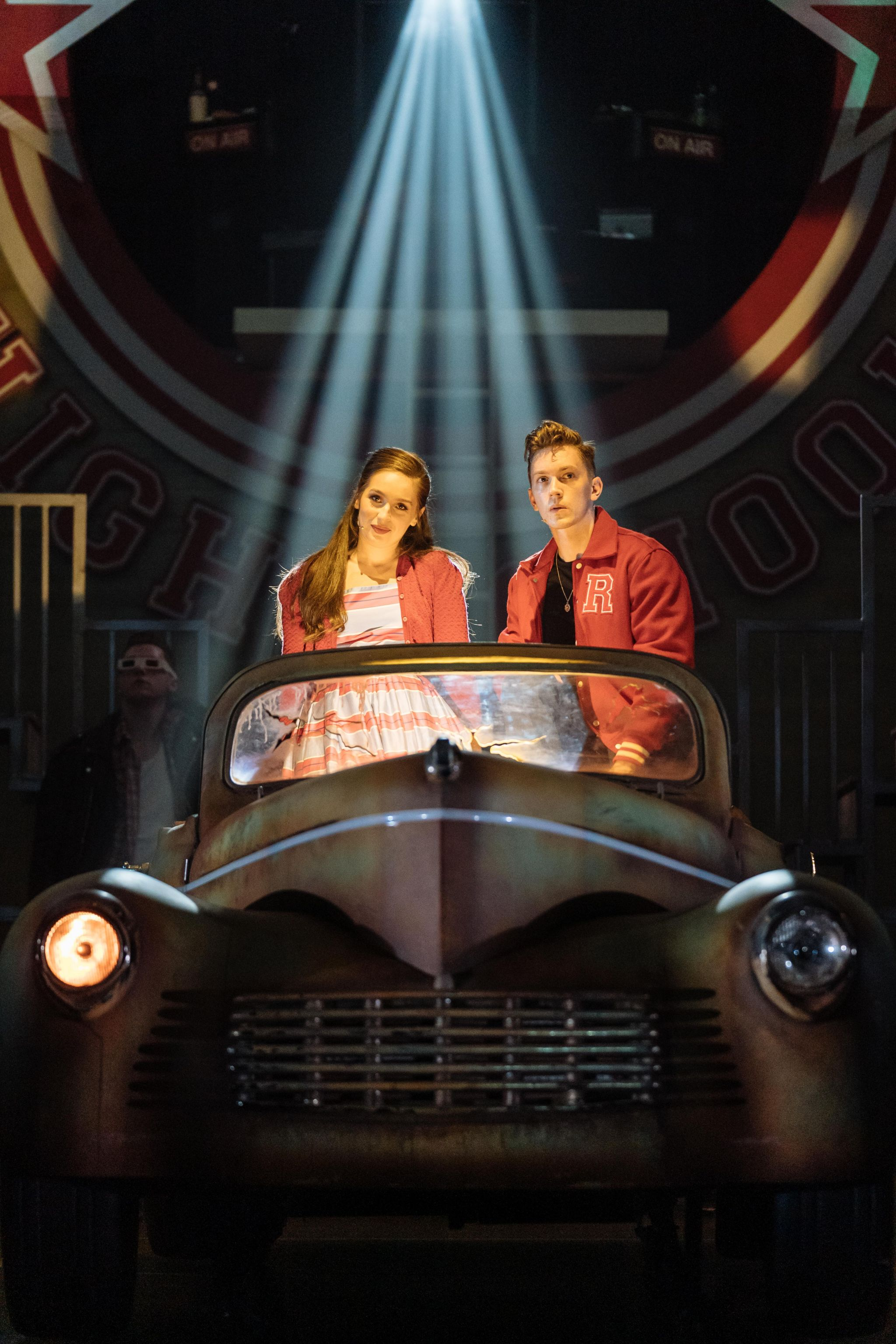 Martha Kirby as Sandy and Dan Partridge as Danny in the UK and Ireland tour of GREASE, credit Manuel Harlan